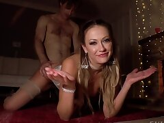 Guy fucks good-looking bitch in a corset by burning fireplace