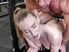 Strong dude is banging hot blonde in the empty gym