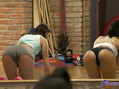 Accommodate girl Bambi Joli enjoys having lesbian sex on the gym floor