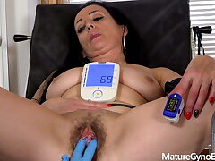 Hot of age brunette made to cum in gyno easy chair by 2 doctors