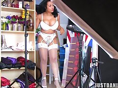 Naughty cougar Danica Collins loves teasing the camera while dressing