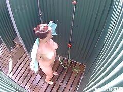 Brunette Milf Showering Down Public Pool