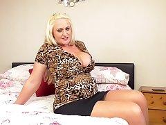 Buxom British blonde mature amateur MILF Sarah Daniel strips