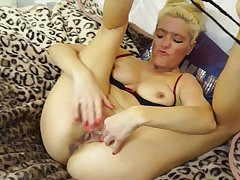 Mature blonde amateur solo model Judy masturbates in the shower