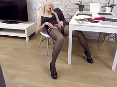 Long legged auburn MILF Zara loves petting herself on the chair