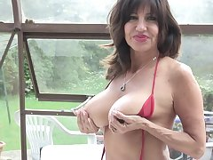 Tara Holiday exposes her huge tits with an increment of plays with her pussy
