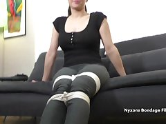 Dude ties up a clothed brunette full-grown lady on camera