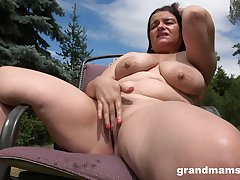 Simmering milf masturbates in the garden thinking about hard penis