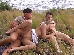 Sexual delight in outdoor threesome for transmitted to slim flaxen-haired