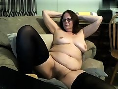 Grown-up stockings uses toy to masturbate