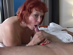 Red haired granny, Angie Summers is having hardcore sex with a younger guy from transmitted to neighborhood